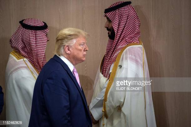 President Donald Trump and Saudi Arabia's Crown Prince Mohammed Bin Salman arrive for a meeting on World Economy at the G20 Summit in Osaka on June...