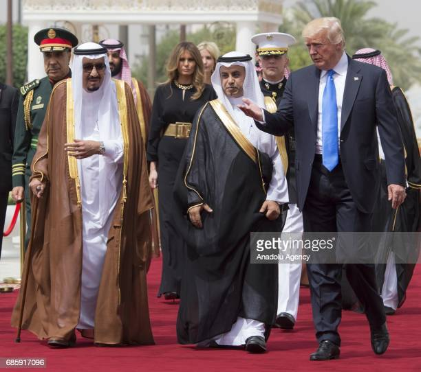 US President Donald Trump and Saudi Arabia's King Salman bin Abdulaziz Al Saud walk past hnor guard during official welcome ceremony piror to their...