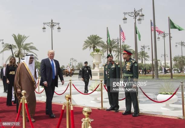 US President Donald Trump and Saudi Arabia's King Salman bin Abdulaziz Al Saud walk past honor guard during official welcome ceremony piror to their...