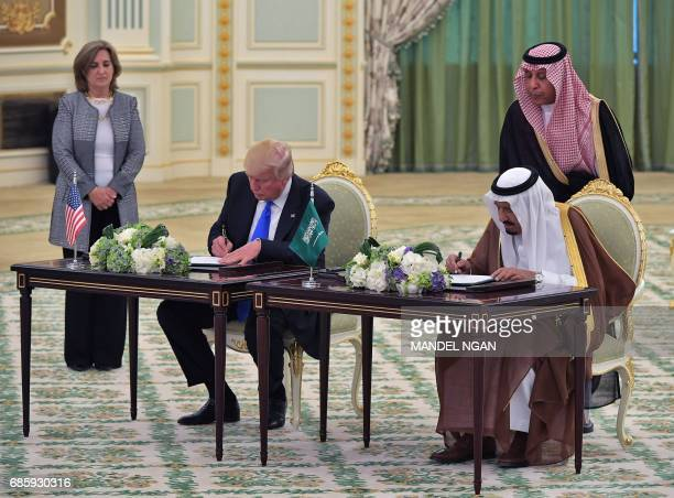 US President Donald Trump and Saudi Arabia's King Salman bin Abdulaziz alSaud take part in a signing ceremony at the Saudi Royal Court in Riyadh on...
