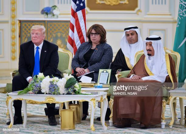 US President Donald Trump and Saudi Arabia's King Salman bin Abdulaziz alSaud watch a signing ceremony at the Saudi Royal Court in Riyadh on May 20...