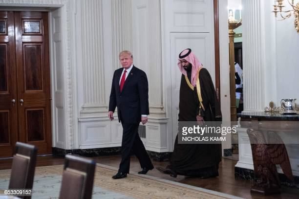 US President Donald Trump and Saudi Deputy Crown Prince and Defense Minister Mohammed bin Salman enter the State Dining Room before lunch at the...