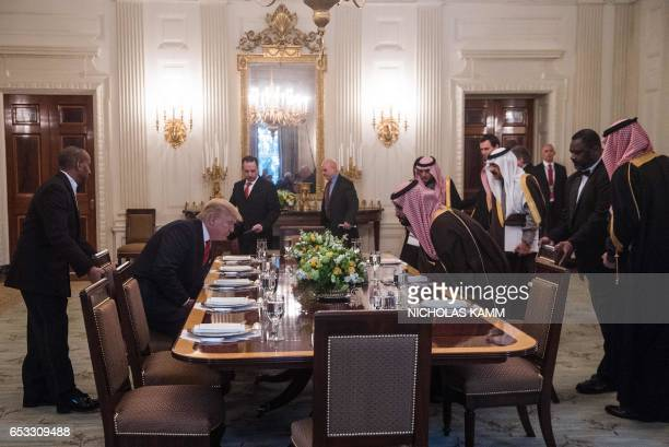 US President Donald Trump and Saudi Deputy Crown Prince and Defense Minister Mohammed bin Salman take their seats for lunch in the State Dining Room...