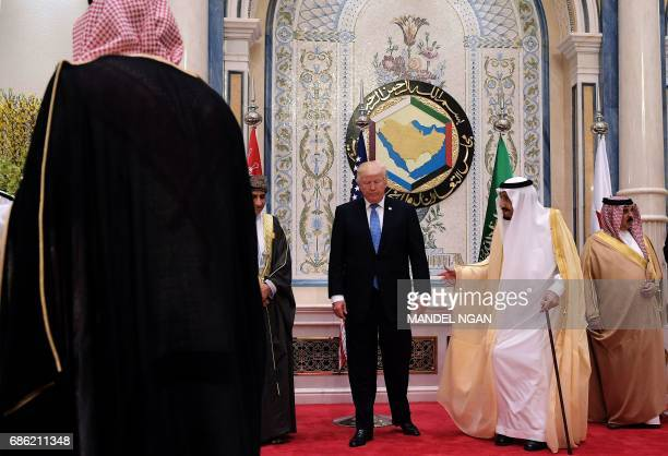 US President Donald Trump and Saudi's King Salman bin Abdulaziz alSaud pose for a picture with leaders of the Gulf Cooperation Council in Riyadh on...