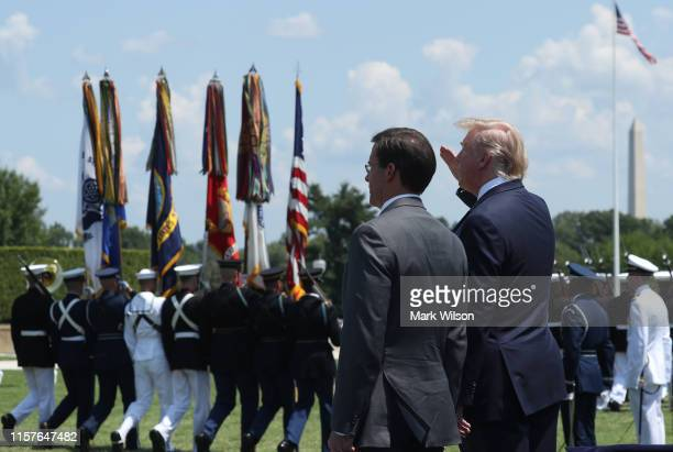 S President Donald Trump and Secretary of Defense Dr Mark Esper inspect the troops during a full honors welcome ceremony on the parade grounds at the...
