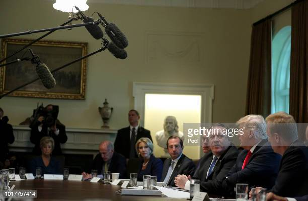 President Donald Trump and Secretary of State Mike Pompeo speak during a cabinet meeting in the Cabinet Room of the White House on August 16 2018 in...