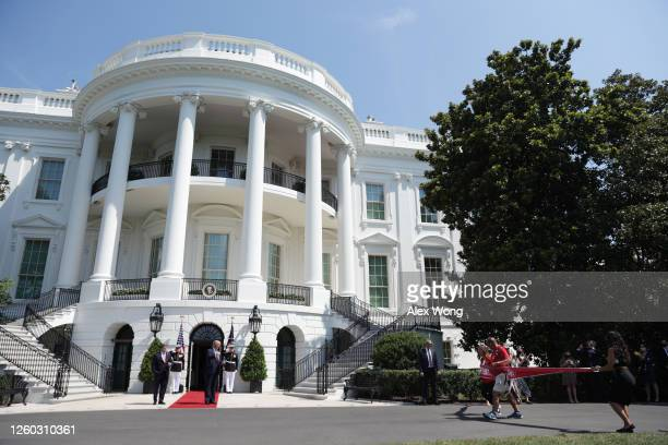 """S President Donald Trump and Secretary of Veterans Affairs Robert Wilkie watch as the """"Walking Marine"""" Terry Sharpe accompanied by Karen Pence wife..."""