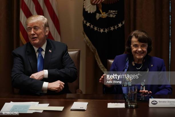 S President Donald Trump and Sen Dianne Feinstein share a moment during a meeting with bipartisan members of the Congress at the Cabinet Room of the...