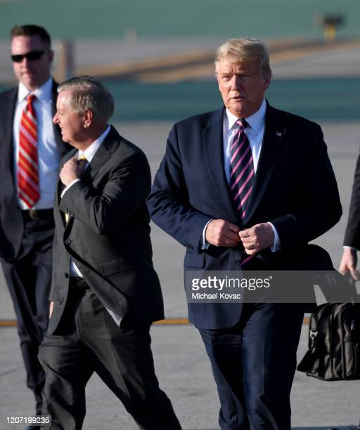 S President Donald Trump and Senator Lindsey Graham walk to greet supporters after arriving on Air Force One at LAX Airport on February 18 2020 in...