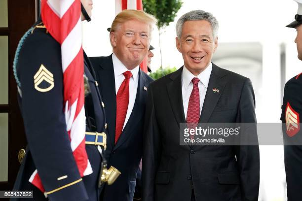 S President Donald Trump and Singapore Prime Minister Lee Hsien Loong pose for photographers outside the White House West Wing October 23 2017 in...