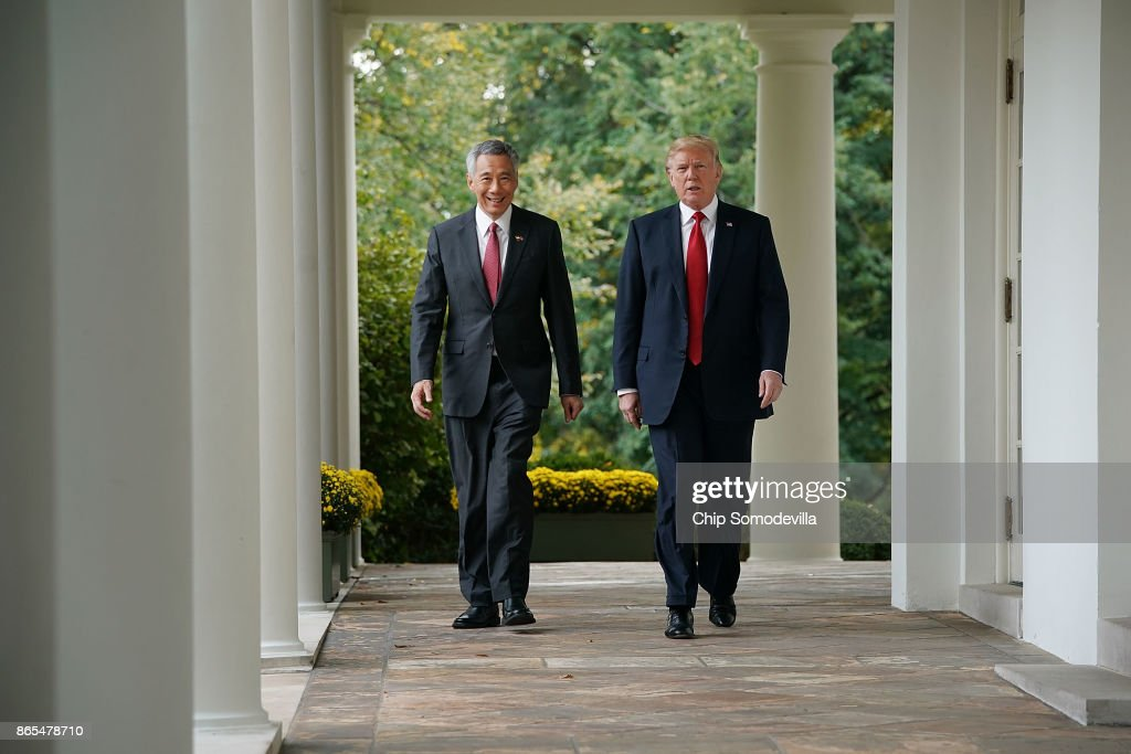 U.S. President Donald Trump (R) and Singapore Prime Minister Lee Hsien Loong walk into the Rose Garden before delivering joint statements to the press at the White House October 23, 2017 in Washington, DC. Trump and Lee are meeting ahead of Trump's first official visit to Asia to attend the APEC and ASEAN meetings during the first two weeks of November.