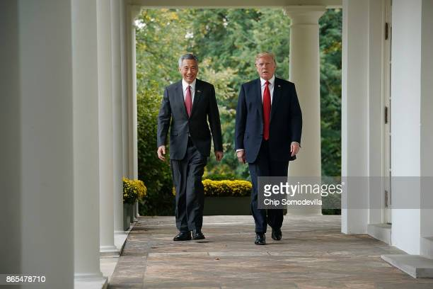 S President Donald Trump and Singapore Prime Minister Lee Hsien Loong walk into the Rose Garden before delivering joint statements to the press at...