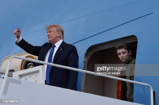 US President Donald Trump and son Barron Trump arrive at Palm Beach International Airport in West Palm Beach Florida January 17 2020