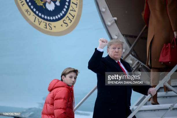 US President Donald Trump and son Barron Trump board Air Force One at Andrews Air Force Base February 1 2019 in Maryland en route to Palm Beach...