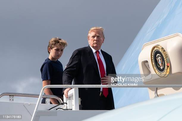 US President Donald Trump and son Barron Trump board Air Force One upon departure from Palm Beach International Airport in Florida on March 31 2019...