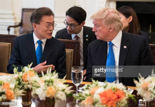 US President Donald Trump and South Korean President Moon Jaein address the media prior to dinner in the State Dinning Room at the White House June...