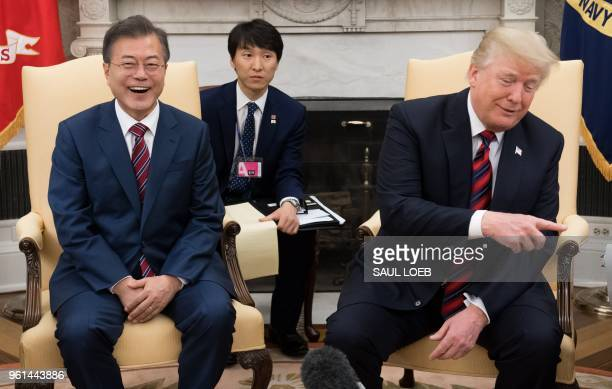 President Donald Trump and South Korean President Moon Jae-in hold a meeting in the Oval Office of the White House in Washington, DC, May 22, 2018. -...