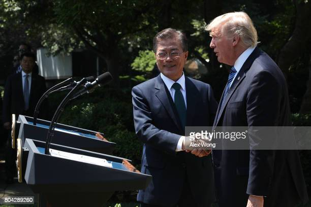 President Donald Trump and South Korean President Moon Jaein shake hands during joint statements in the Rose Garden of the White House on June 30...