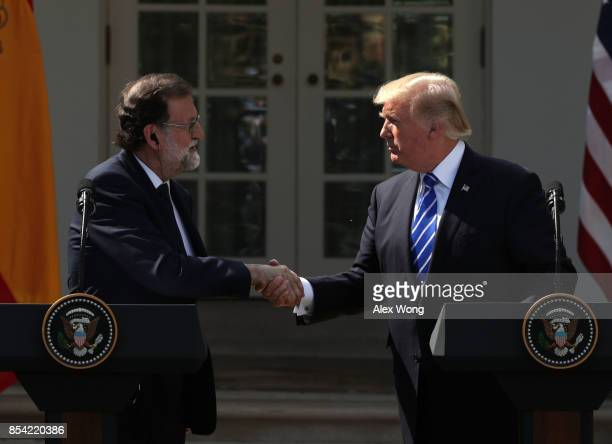 S President Donald Trump and Spanish Prime Minister Mariano Rajoy shake hands during a joint news conference at the Rose Garden of the White House...