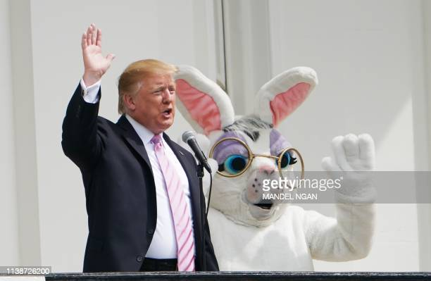 President Donald Trump and the Easter Bunny wave during the annual White House Easter Egg Roll on the South Lawn of the White House in Washington DC...