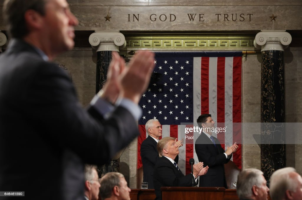 U.S. President Donald Trump and the entire chamber reacts towards Carryn Owens, widow of Navy Seal Ryan Owens, as Trump delivers his first address to a joint session of the U.S. Congress on February 28, 2017 in the House chamber of the U.S. Capitol in Washington, DC. Trump's first address to Congress focused on national security, tax and regulatory reform, the economy, and healthcare.