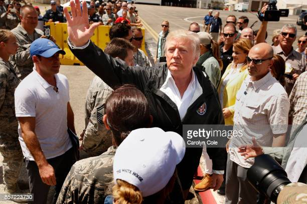 President Donald Trump and the First Lady arrive at the Muniz Air National Guard Base in Carolina Puerto Rico on Oct 3 almost two weeks after...