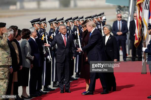 S President Donald Trump and the First Lady Melania Trump are accompanied by the South Korean Minister of Foreign Affairs Kang Kyunghwa and...