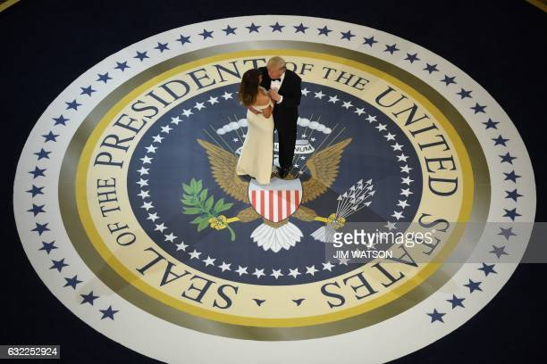 President Donald Trump and the first lady Melania Trump dance at the Armed Services ball at the National Building museum following Donald Trump's...