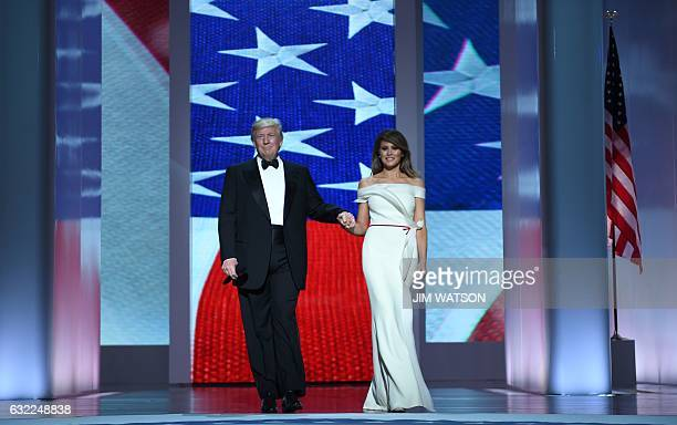 US President Donald Trump and the first lady Melania Trump enter the Liberty Ball at the Washington DC Convention Center following Donald Trump's...