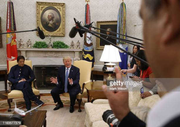 S President Donald Trump and the Prime Minister of the Islamic Republic of Pakistan Imran Khan speak to the media in the Oval Office at the White...