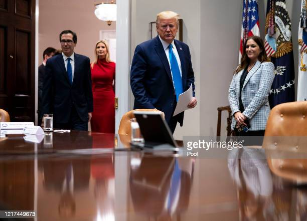 President Donald Trump and Treasury Secretary Steven Mnuchin and the president's daughter Ivanka Trump arrive for a video conference with...