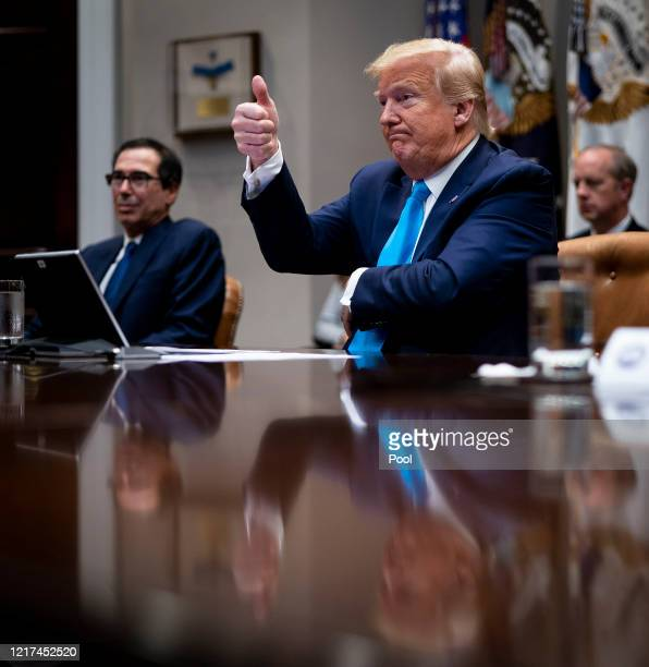 S President Donald Trump and Treasury Secretary Steven Mnuchin participate in a video conference with representatives of large banks and credit card...