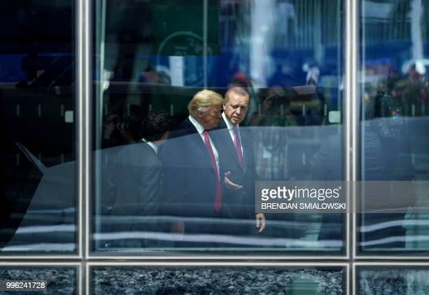 President Donald Trump and Turkey's President Recep Tayyip Erdogan speak as they attend the NATO summit at the NATO headquarters in Brussels on July...