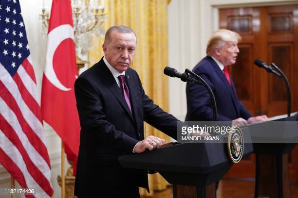 US President Donald Trump and Turkey's President Recep Tayyip Erdogan take part in a joint press conference in the East Room of the White House in...