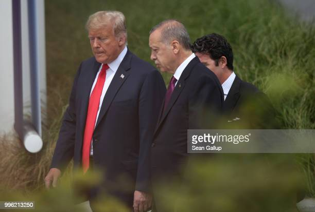 S President Donald Trump and Turkish President Recep Tayyip Erdogan attend the opening ceremony at the 2018 NATO Summit at NATO headquarters on July...