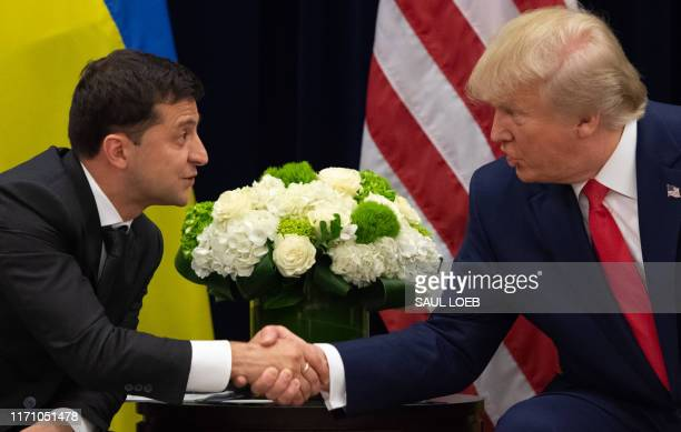 President Donald Trump and Ukrainian President Volodymyr Zelensky shake hands during a meeting in New York on September 25 on the sidelines of the...