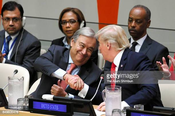 US President Donald Trump and United Nations Secretary General Antonio Guterres shake hands during a general assembly meeting on the United Nations...