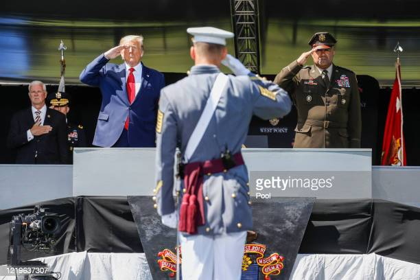President Donald Trump and United States Military Academy superintendent Darryl A. Williams salute alongside graduating cadets as the national anthem...
