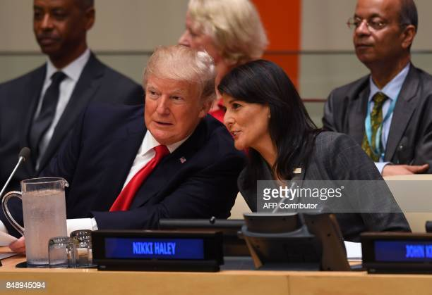 US President Donald Trump and US ambassador to the United Nations Nikki Haley speak during a meeting on United Nations Reform at the United Nations...