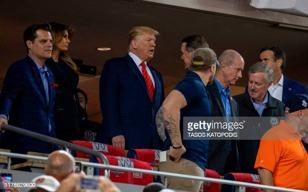 US President Donald Trump and US First Lady Melania attend Game 5 of the World Series between the Washington Nationals and Houston Astros at...