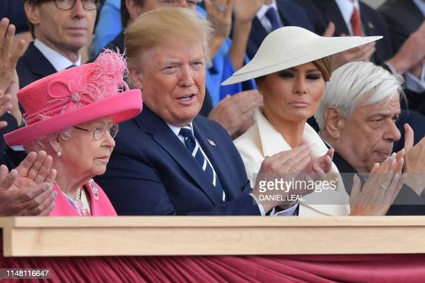 US President Donald Trump and US First Lady Melania Trump applaud after Britain's Queen Elizabeth II made her address during an event to commemorate...
