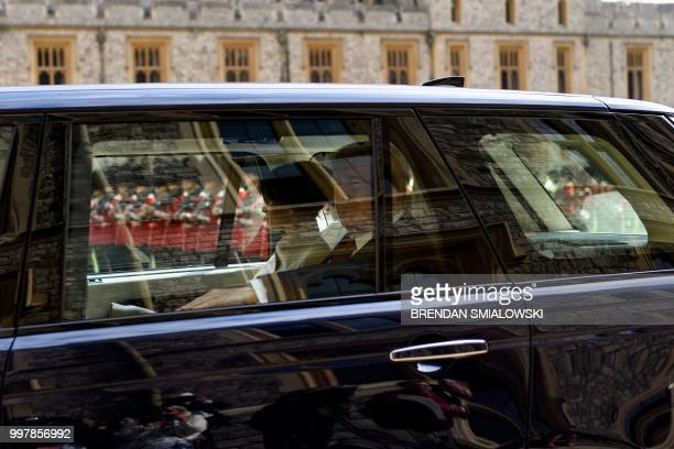 US President Donald Trump and US First Lady Melania Trump arrive at Windsor Castle in Windsor west of London on July 13 2018 for an engagement with...