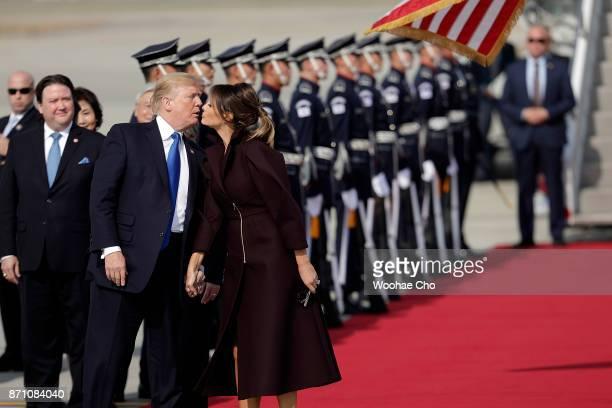 S President Donald Trump and US First Lady Melania Trump arrive at Osan Air Baseon November 7 2017 in Pyeongtaek South Korea Trump is in South Korea...