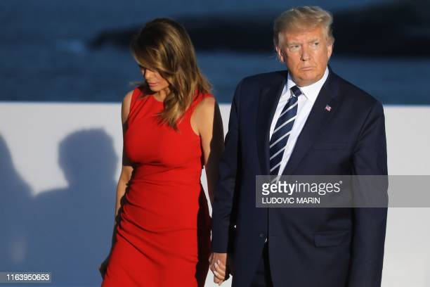 US President Donald Trump and US First Lady Melania Trump arrive for a family picture with G7 leaders and guests on the second day of the annual G7...