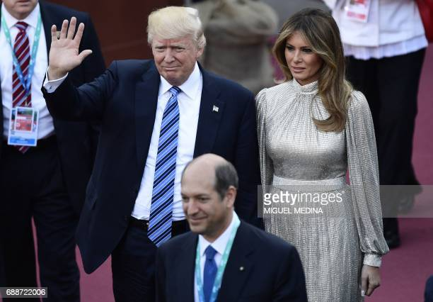 President Donald Trump and US First Lady Melania Trump arrive for a concert of La Scala Philharmonic Orchestra at the ancient Greek Theatre of...