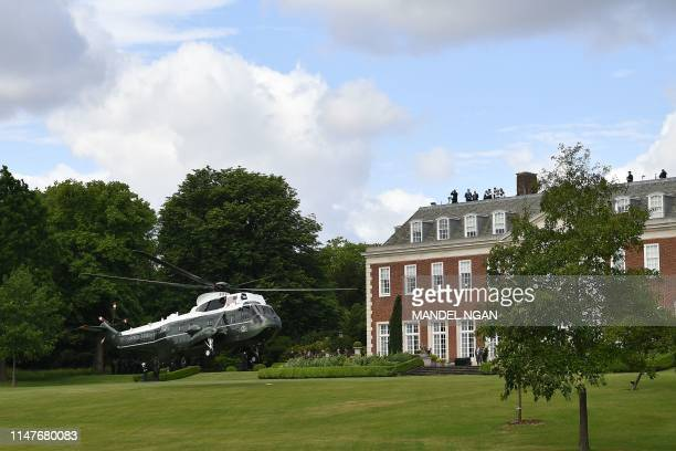 US President Donald Trump and US First Lady Melania Trump arrive in Marine One at Winfield House the residence of the US Ambassador in London on June...
