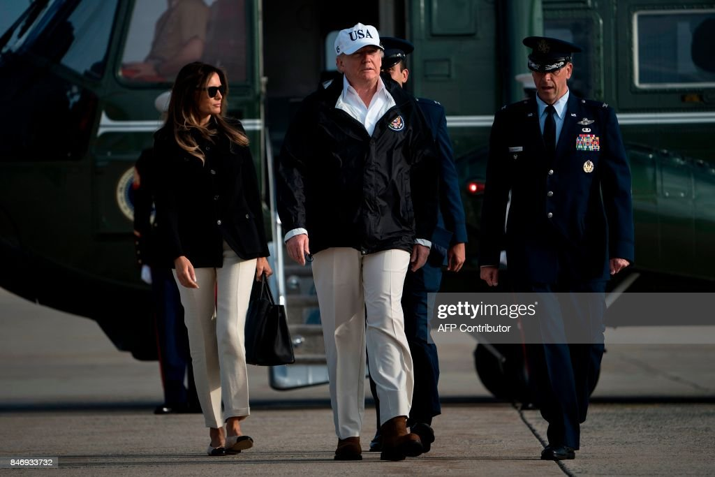 US President Donald Trump and US First Lady Melania Trump arrive to board Air Force One at Andrews Air Force Base in Maryland on September 14, 2017, as they travel to Florida . The Trumps will visit areas affected by Hurricane Irma. / AFP PHOTO / Brendan Smialowski