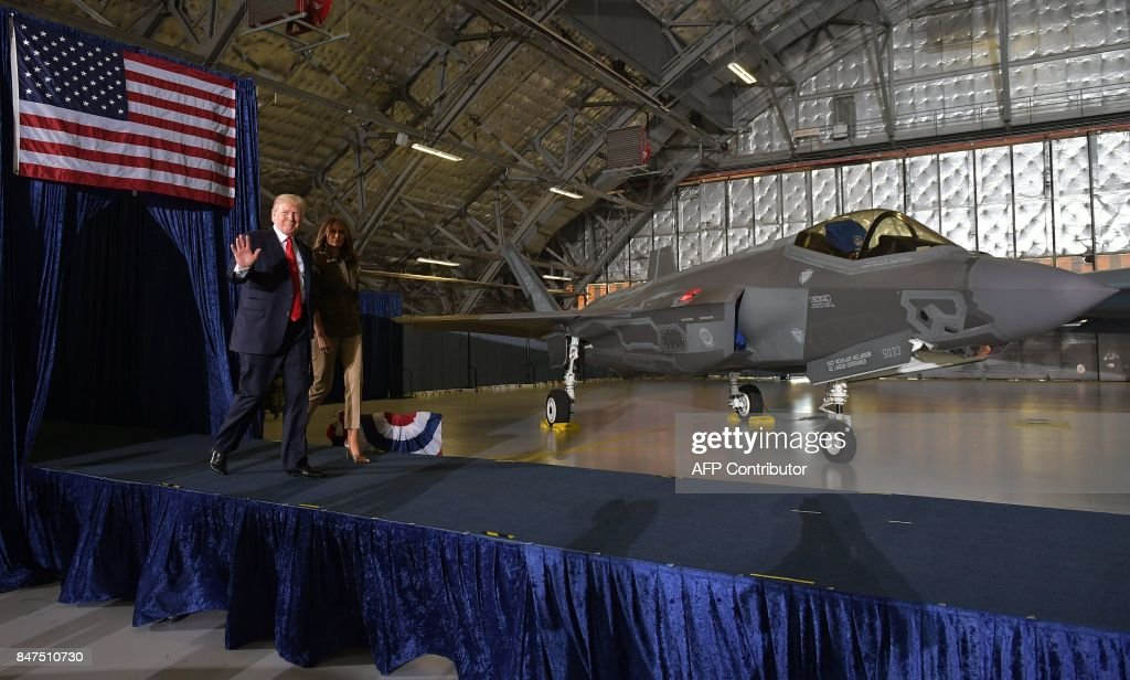 US President Donald Trump (L) and US First Lady Melania Trump arrive to speak at Joint Andrews Airforce base, Maryland on September 15, 2017. /