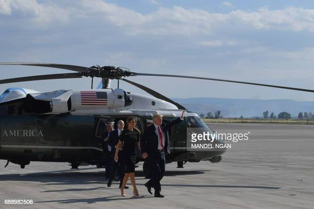 President Donald Trump and US First Lady Melania Trump arrive to meet US military personnel and families at Naval Air Station Sigonella after G7...