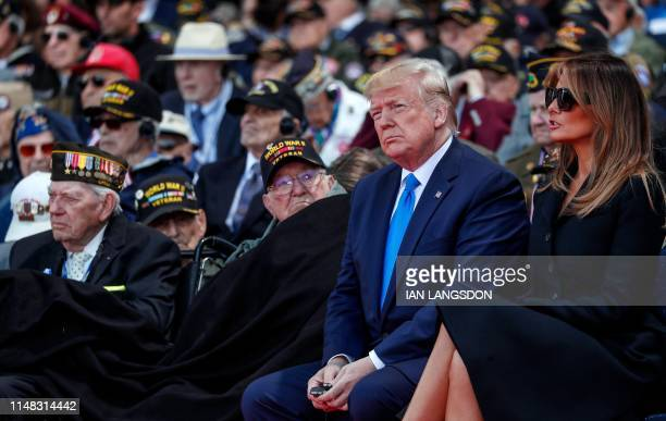 US President Donald Trump and US First Lady Melania Trump attend a FrenchUS ceremony at the Normandy American Cemetery and Memorial in...
